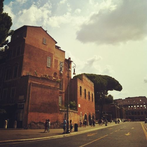 Strolling to the Colosseo on the new pedestrian Via dei Fori Imperiali. GetYourGuide Cityscapes Rome
