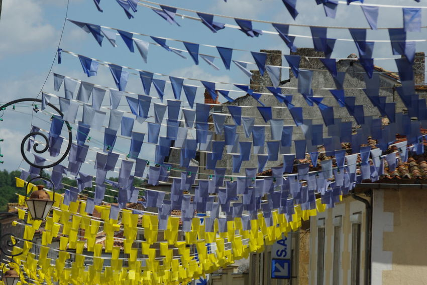 Festival Season Blue And Yellow Colour Day Flying In The Wind Guirlandes No People Outdoors Summer