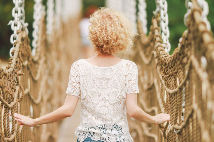 Back View Basket Bridge Casual Clothing Close-up Curly Day Focus On Foreground Girl Hair Holding Leisure Activity Lifestyles Outdoors Part Of Selective Focus Sentosa Touching White Shirt Original Experiences Feel The Journey Break The Mold Connected By Travel