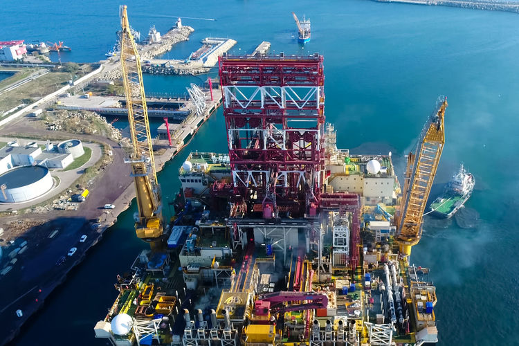Water Sea High Angle View Transportation Industry Mode Of Transportation Nautical Vessel No People Machinery Aerial View Nature Oil Industry Shipping  Crane - Construction Machinery Oil Freight Transportation Business Outdoors Architecture