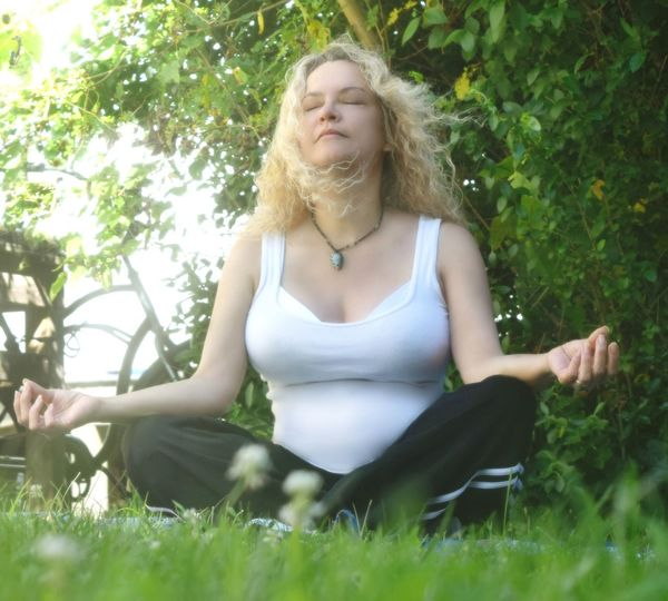 Cross-legged Front View Green Color Long Hair Meditation Nature Outdoors Relaxation Sitting Tranquility