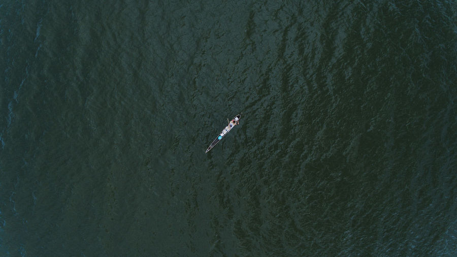 High angle view of person on rowboat in sea