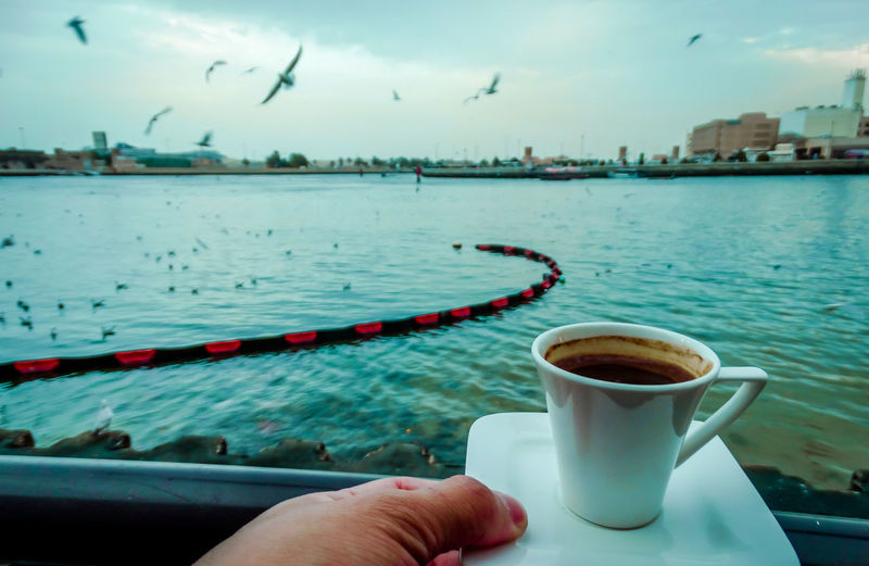 Bay Building Exterior By The Bay Close-up Coffee Coffee - Drink Coffee Cup Coffee Cups Corniche Day Drink Drinking Espresso Food And Drink Freshness No People Outdoors Popular Photos Refreshment Sky Taking Photos The Week Of Eyeem Turkish Coffee Turkishcoffee Water