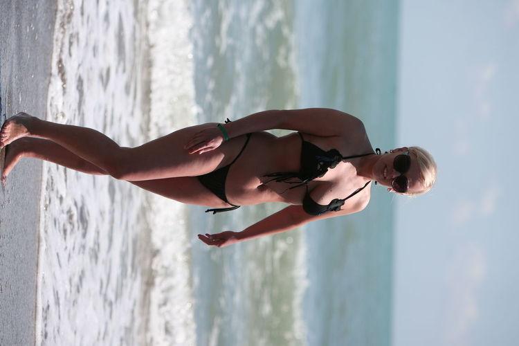 slim or fat girl with strings swinsuit, swiming in italian sea Bath Blonde Hair Fashionable Baby Italia Italiangirl Like A Model Mother & Daughter Pose Slim Or Fat ? Smimming Blong Girl Swimming Water