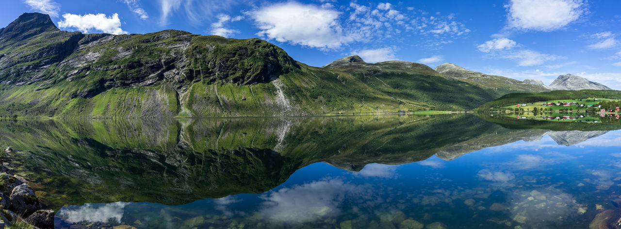 Wide panorama of Eidsvatnet lake near Geirangerfjord with amazing reflections in the water, Sunnmore, More og Romsdal, Norway Norway Norway🇳🇴 Norwegen Scandinavia Geirangerfjord Geiranger Geiranger Fjord Geirangerfjorden Northern Europe Mountain Water Scenics - Nature Reflection Beauty In Nature Lake Sky Cloud - Sky Tranquility Tranquil Scene Nature Day Idyllic Mountain Range Non-urban Scene No People Waterfront Green Color Outdoors