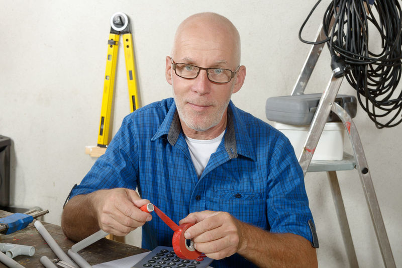 Portrait of plumber working at workbench
