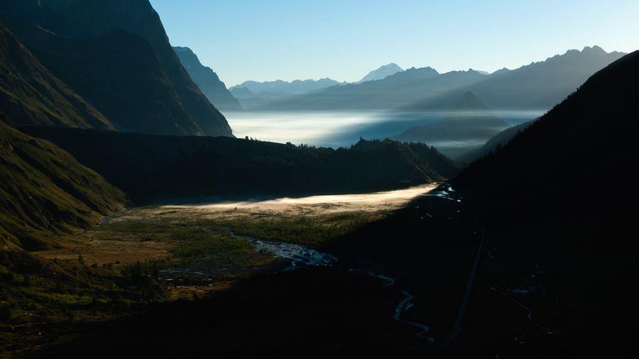 Early morning fog in the mountains. Sunrise Foggy Morning Fog Mountain Beauty In Nature Scenics - Nature Sky Mountain Range No People Nature Tranquil Scene Environment Sunlight