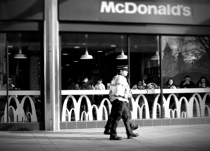 Mcdonalds monochrome photography Black And White Swindon Town Centre Street Photography Policemen Swindon City Building Exterior Store Window