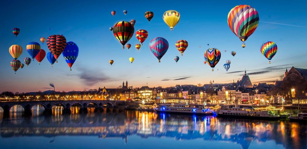 View of hot air balloons in city at night
