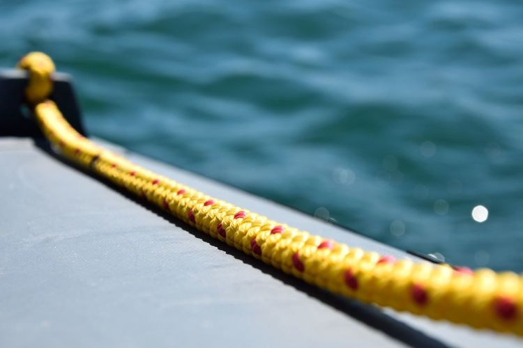 Close-Up Of Rope On Boat In Sea