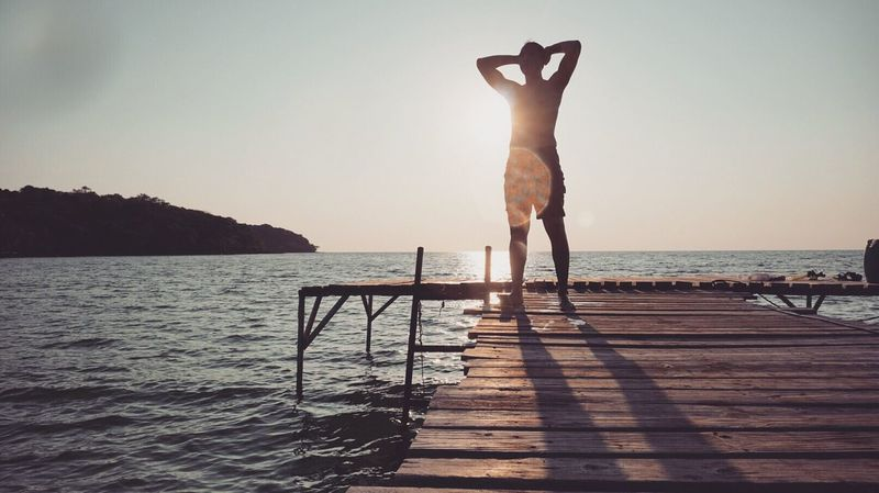 Yep! that's my man! 😝 Swim Man Wood Bridge Sunlight Sunset Sunrise Muscle Beach Ocean Island Iphone6photo Happy Moment Vacation Summer Shadow The Essence Of Summer The Essence Of Summer- 2016 EyeEm Awards Silhouette 43 Golden Moments Showcase June Eyeemphoto