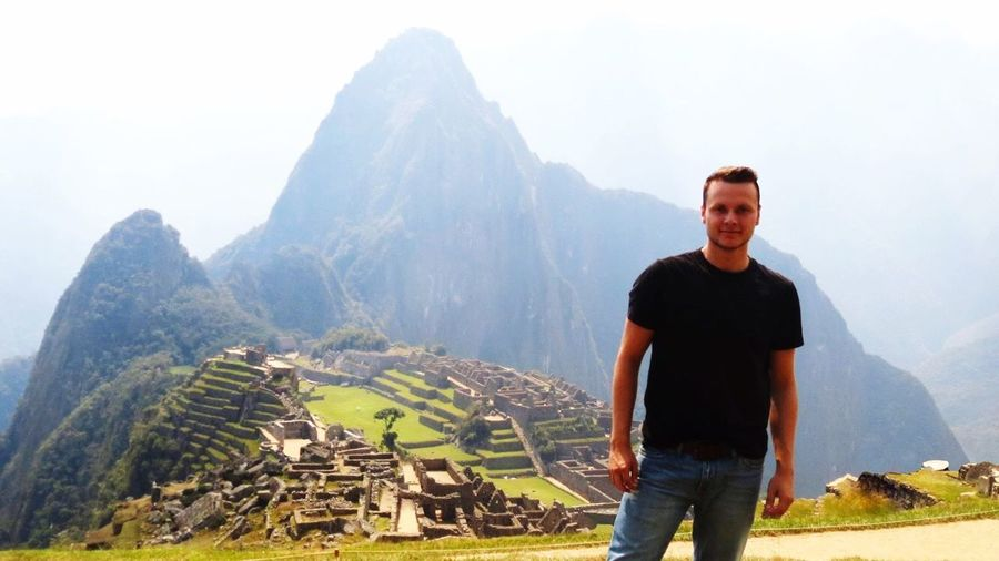 Portrait of young man standing at machu picchu