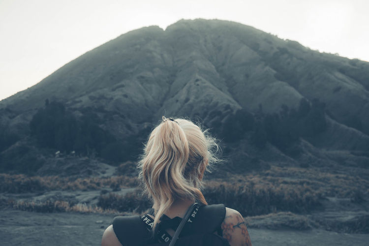 Rear view of woman against mountains