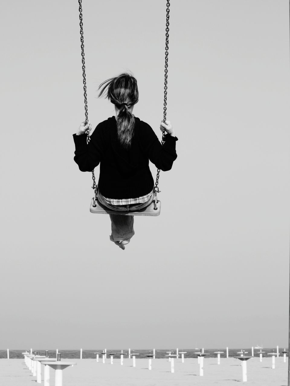 WOMAN WITH ROPE AGAINST SKY