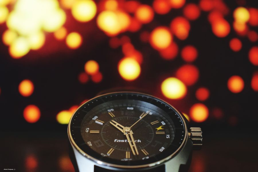 Don't watch the clock; do what it does. Keep going Clicked On Nikon D3300 Bokeh Background Orange Color Wristwatch Checking The Time Watch