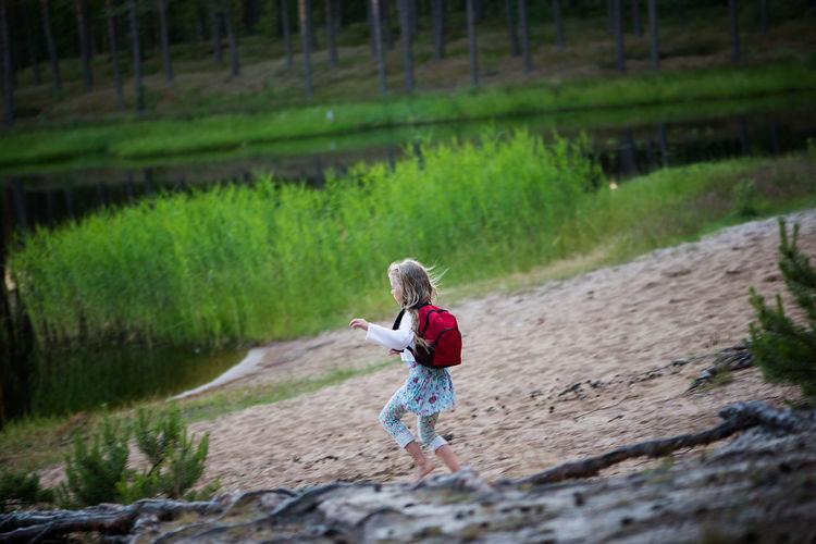 Full length of girl running