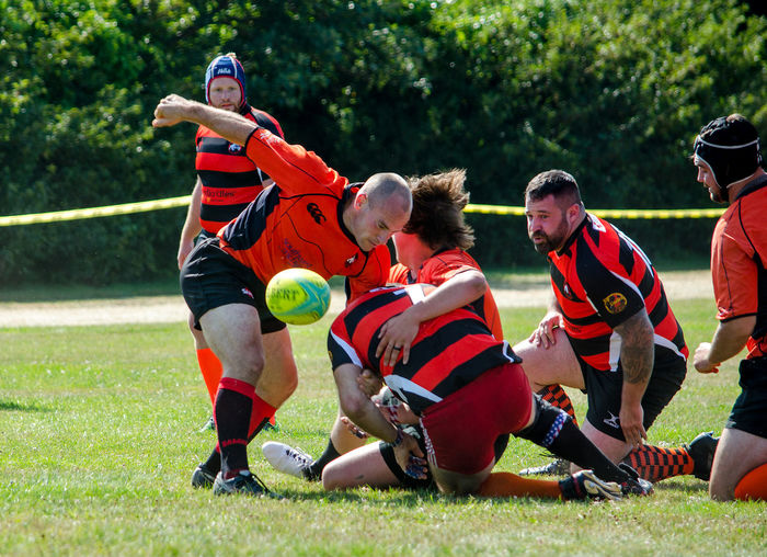 August 2017; two teams demonstrate how rugby is played at the Kalamazoo Scottish festival in Michigan USA Diversity Fun Happy Hot Rugby Ball TEAMS Uniform Active Adults Casual Clothing Clothing Clothing Store Competition Day Female Group Of People Lift Men Nature People Play Rugby Skirmish Sport Women The Photojournalist - 2018 EyeEm Awards Human Connection