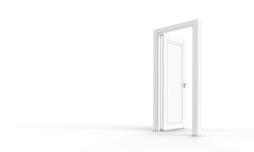 Open door on white wall