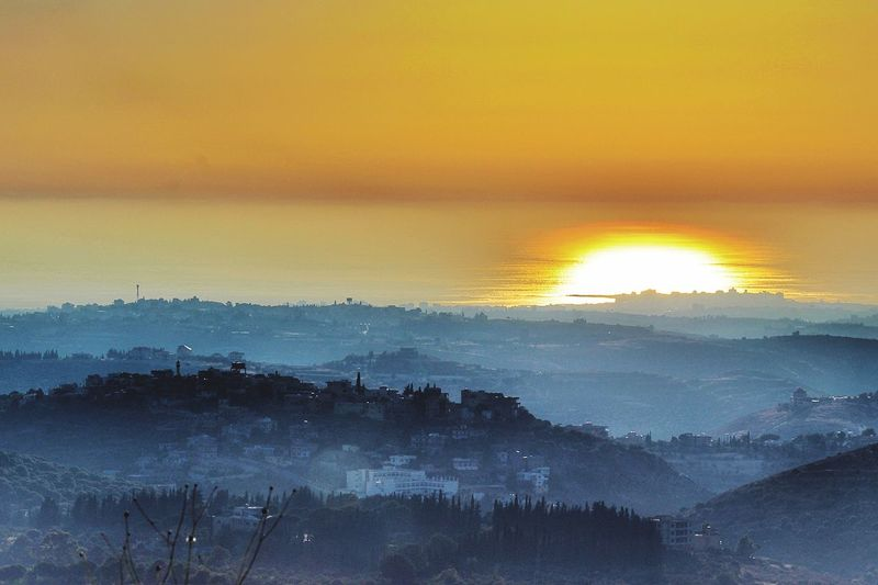 Beauty In Nature Nature Sunset Scenics Tranquility Tranquil Scene Tree No People Outdoors Idyllic Landscape Sun Mountain Fog Sky Day Lebanon