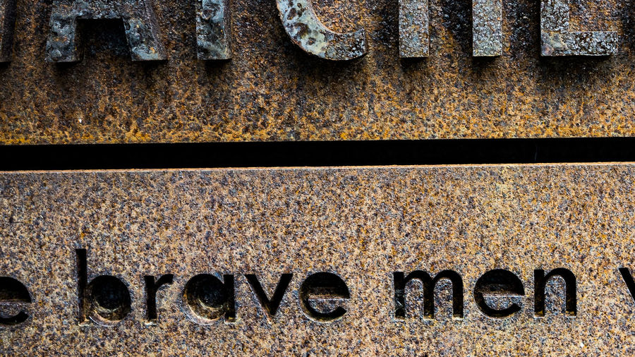 Brave Brave Men Backgrounds Capital Letter Close-up Communication Directly Above Dirty Full Frame History Men Metal No People Old Pattern Rail Transportation Run-down Rusty Text The Past Track Western Script