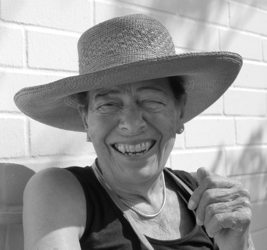 Portrait of smiling woman wearing hat outdoors