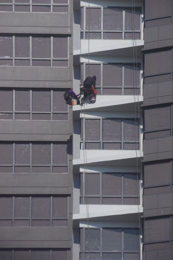 skyscraper windows cleaner Skyscraper Windows Cleaner Skyscraper Windows Window Windows Cleaner Cleaning Cleaner High Building Exterior Building Condo Condominium Window Washer Manual Worker Working City Men Skill  Cleaning Tall - High Construction Worker Skyscraper Tower