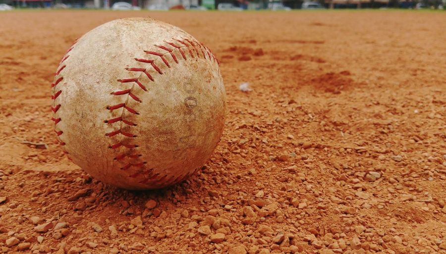 Close-up of baseball on field