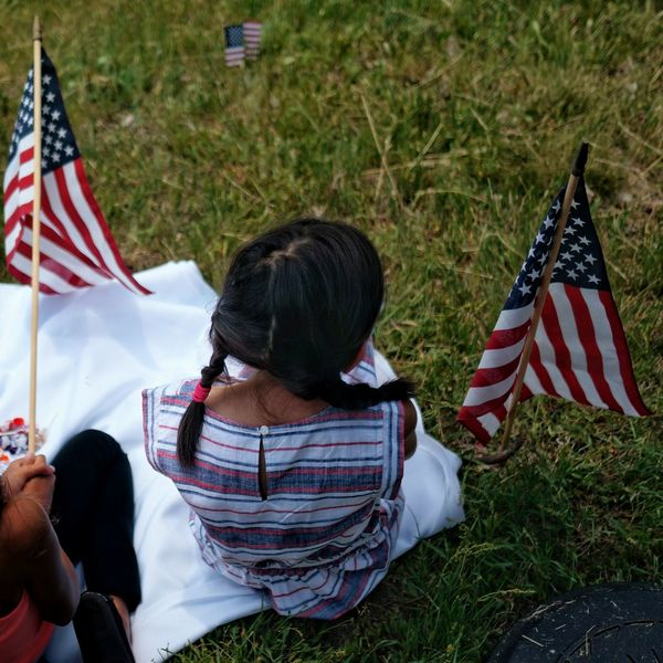Waiting for the parade. Essence Of Summer Memorial Day Americana American Flag Red, White And Blue Kids Relaxing Parade Sitting On Grass The Essence Of Summer