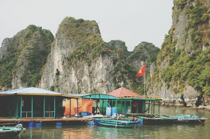 Nautical Vessel Travel Destinations Vietnam Vietnam Flag Halong Bay  Halong Bay Vietnam Beauty In Nature Mode Of Transport Sea View Boat Boat Villa Vilage Seascape Sky And Clouds Scenics Tourism Mountains Tradition Vietnam Hat Mountain Nature Vietnam Travel Leisure Activity Mountain Range Cloudy
