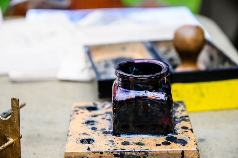 Close-up of ink well on table
