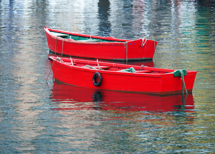 High angle view of red boat moored in lake