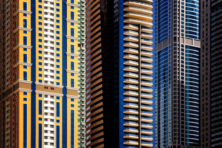 Majestic colorful dubai marina skyscrapers. Detail of world tallest residential buildings. Dubai marina, United Arab Emirates. Dubai Dubai Marina United Arab Emirates Apartment Architecture Backgrounds Building Building Exterior Built Structure City Day Detail Financial District  Full Frame Low Angle View Modern No People Office Office Building Exterior Outdoors Skyscraper Tall - High Tower Travel Destinations Window