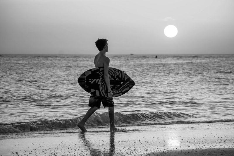 At Days End B&W Portrait Calm Gulf Coast Horizon Over Water Leisure Activity Lifestyles Ocean Outdoors Sea Seascape Shore Skimboarding Sun Treasure Island, FL Water