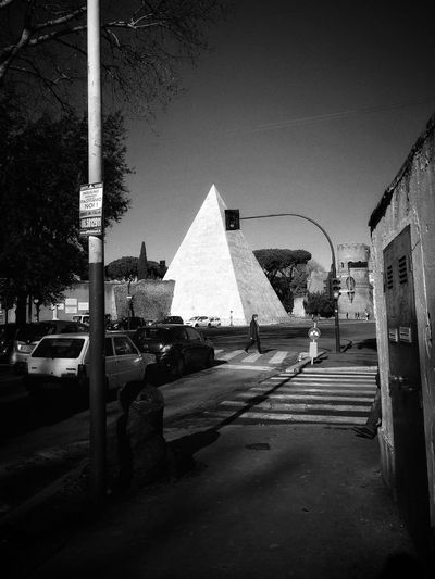 Romanarchitecture Romanempire Pyramid Rome Italy Urban Car Road Transportation Land Vehicle Built Structure Outdoors Architecture City