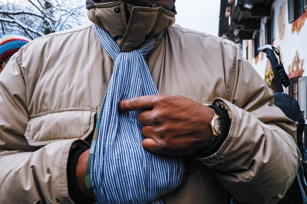 Midsection Of Man In Warm Clothing Outdoors