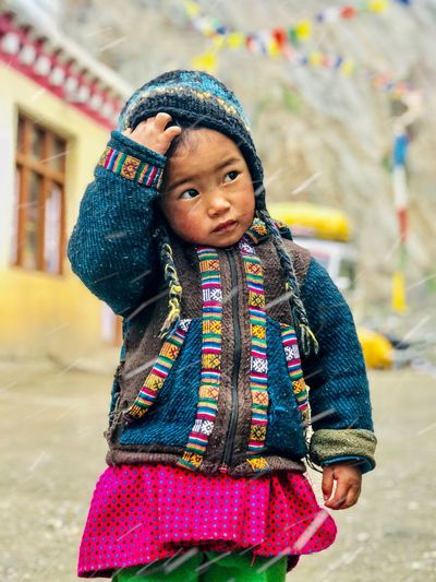Girl looking away while standing in winter