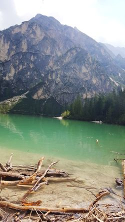 Lago di Braies Trentino Alto-Adige Italy Lake View Montains And Water  Montainlake Green Color Smeraldo Vista Panorama View Panoramic Photography EyeEm Nature Lover EyeEmNewHere EyeEm Gallery Water Mountain Tree Lake Pinaceae Forest Sky Landscape Mountain Range Lakeshore Calm Geology Pine Tree Rock Formation Natural Arch