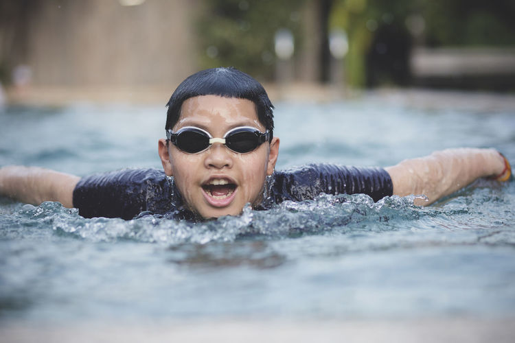 children swimming in water pool Swimming Swim Swimming Pool Sport Child Childhood Children Boy Man Butterfly Water Water Pool Pool Breath Asian  Active Activities Activity Leisure Activity Leisure Health Healthy Face Athlete Athletic
