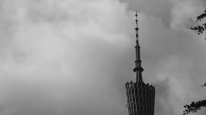 Low Angle View The Architect - 2016 EyeEm Awards Sky Built Structure Cloud - Sky Architecture Tower Tall - High Cloudy Cloud City High Section Outdoors No People Modern Tall Travel Destinations Blackandwhite Blackandwhite Photography Guangzhou Canton China Feel The Journey Battle Of The Cities