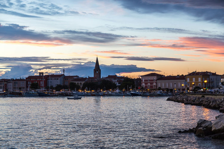 Poreč town in Croatia... Beautiful Sky Croatia Orange Sky Porec, Croatia Poreč Harbour Poreč Marina Poreč Town Architecture Beautiful Skies Building Exterior Built Structure City Cloud - Sky Croatian Town Day Nature No People Outdoors Porec Purple Sky Rocks Sky Sunset Travel Destinations Water