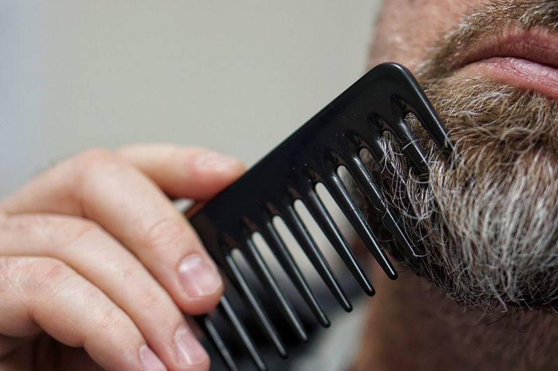man doing his beard Hipster Grow Beard Beardy Man Beard Grooming Comb Human Body Part Human Hand Human Face Indoors  One Person Close-up This Is Masculinity Men Only Men Lifestyles Adult People