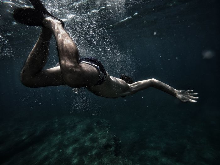 Man Swimming Undersea
