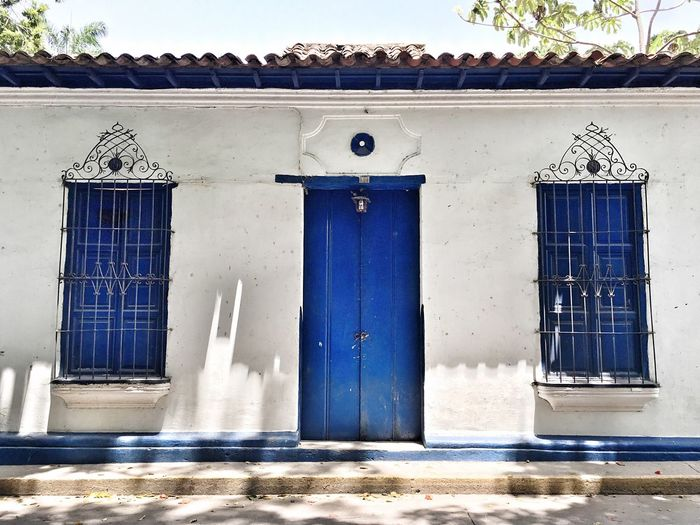 Blue Door Closed Entrance Open Door Colonial Style Colonial Architecture Town Architecture Architecture Built Structure Door Building Exterior Window Entrance House Day Outdoors No People
