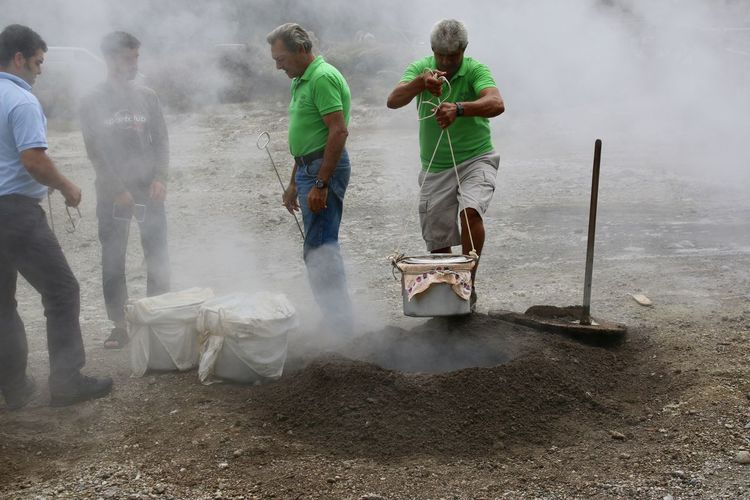 Cooking in Furnas Furnas Cozido Schwefelquelle Smoke - Physical Structure Men Group Of People Real People Day Motion Working Occupation People Water Environment Environmental Issues Outdoors Nature Dirt Casual Clothing Lifestyles Adult Dust