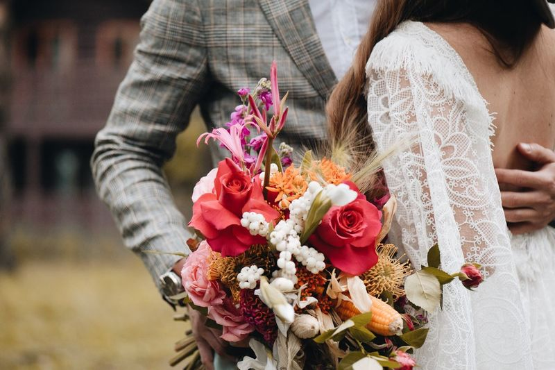 Couple walking in park. Wedding Flower Flowering Plant Midsection Plant Flower Arrangement Adult Celebration Bouquet Nature Women Real People Holding Beauty In Nature Rose - Flower One Person Rosé Lifestyles Focus On Foreground Event Hand Flower Head Bunch Of Flowers