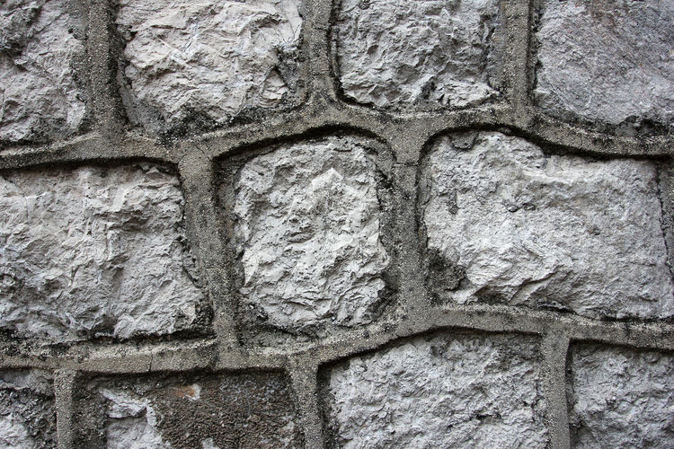 Low angle view of stone wall