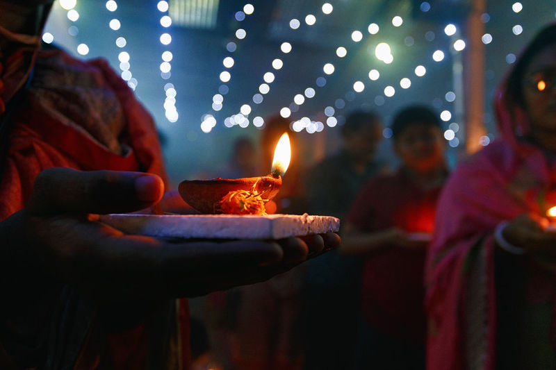 The light of Faith. The Week On EyeEm Burning Celebration Diwali Diya - Oil Lamp Flame Glowing Holding Human Hand Indoors  Night People Real People Togetherness Women HUAWEI Photo Award: After Dark Capture Tomorrow