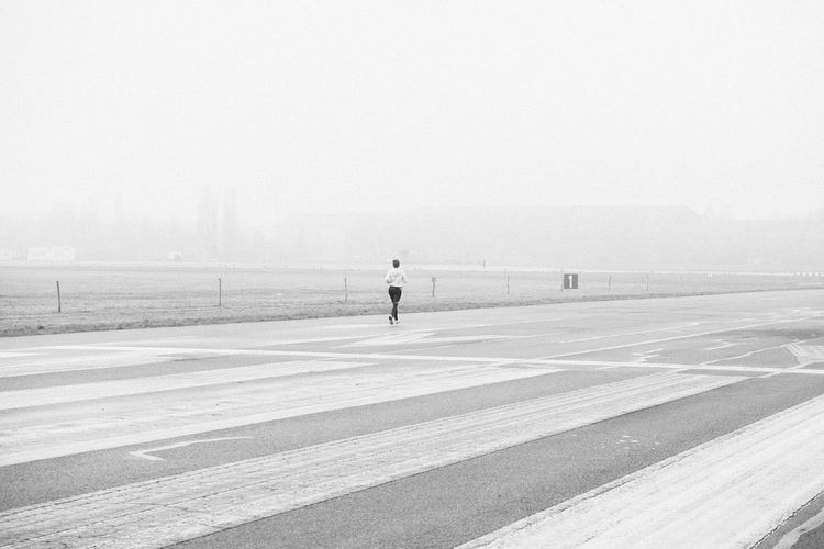 0ne 1 Alone In The City  Berlin Berlin Photography Jogging Time Number One Sport In The City Tempelhofer Feld Activity Fog Jogger Jogging Leisure Leisure Activity Lifestyles One Person Outdoors People Real People Road Runway Sport Tempelhofer Freiheit Walking