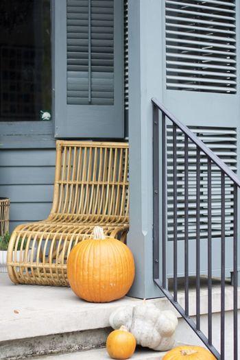Pumpkins on railing of building