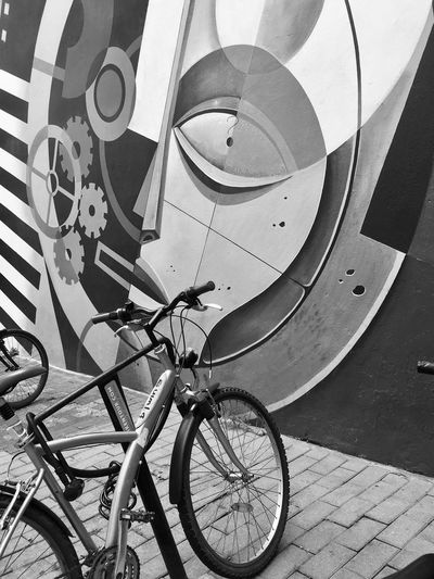 High angle view of bicycle parked by wall